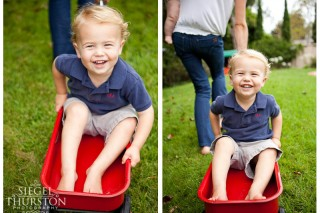 2 year old being pulled in a red radio flyer wagon by his mom