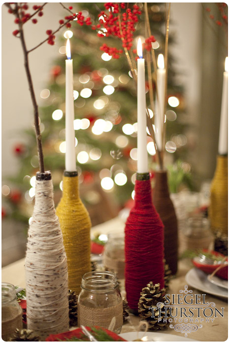 DIY winter table decorations wine bottles wrapped in yarn and spray painted pine cones