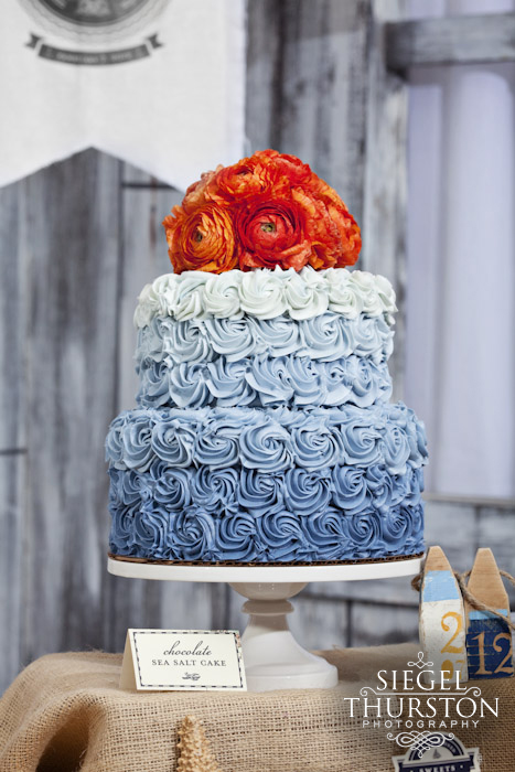 blue and tangerine wedding cake