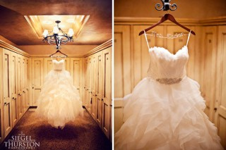 beautiful strapless wedding dress with feathers hanging from chandelier