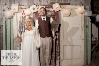 Jeff & Kelsey Wedding fun booth with old wooden doors