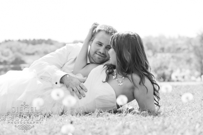 wedding portraits of couple romantically laying in the grass san diego wedding photographers