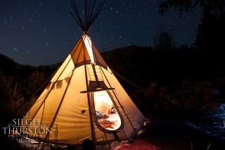 star trails over a teepee on the colorado river