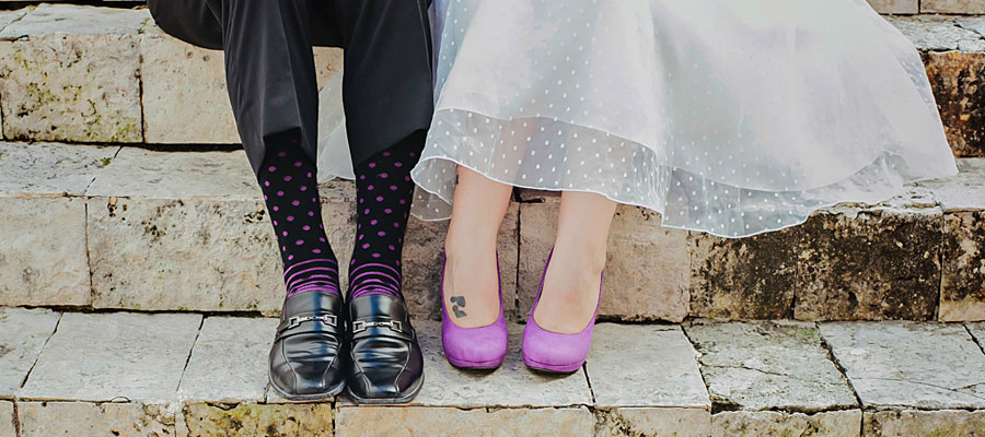 trash the dress playa del carmen destination wedding bride and groom wearing matching purple shoes and socks