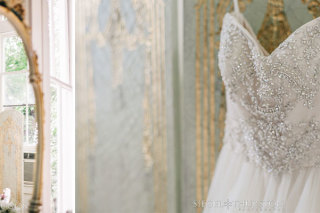 beaded wedding dress hanging on a vintage changing screen in the bridal suite at Green Gables Estates in San Diego