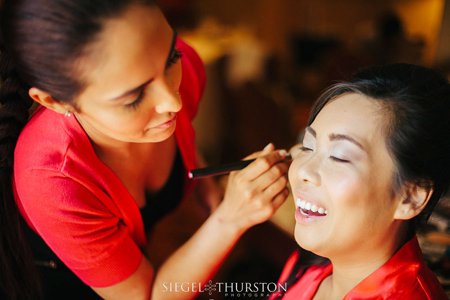 photojournalistic shot of bride getting her makeup done