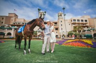 syled engagement shoot with a race horse at the del mar track