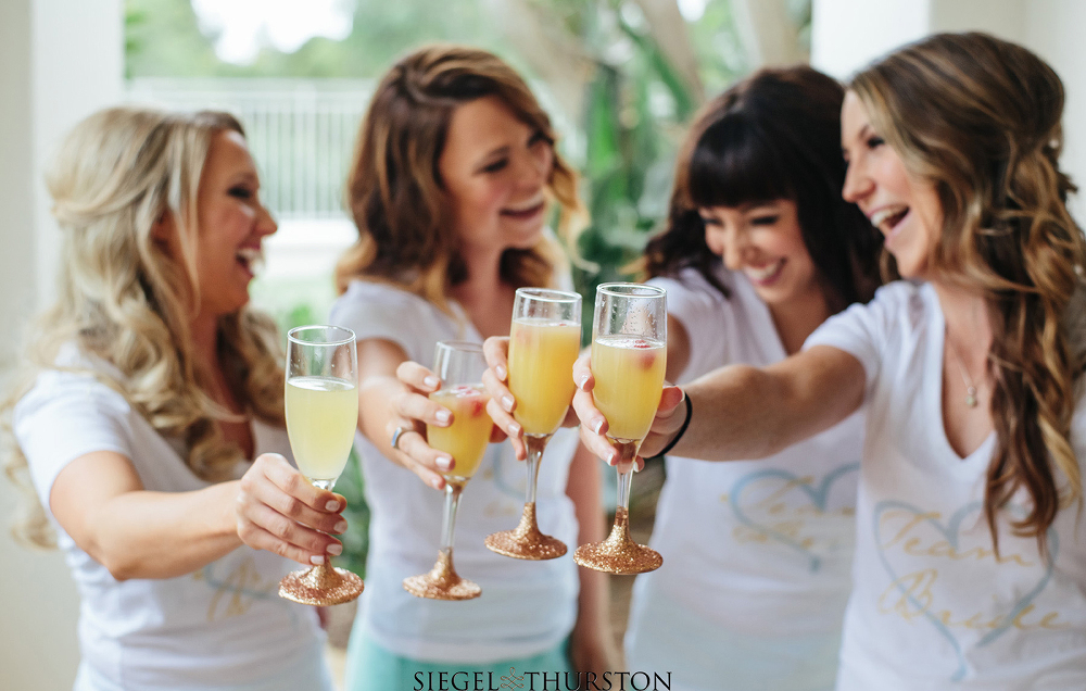 bridesmaids and glitter coated champaign glasses